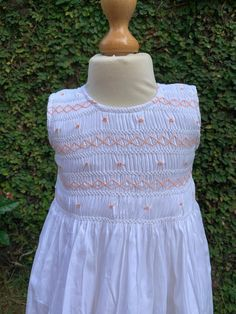 This 100% cotton dress has a beautiful smocked pattern with rows of bullion roses that looks good on the white sleeveless dress. A comfortable nightwear on a long drive. Smocked Dresses For Girls, Cotton Dresses, Flower Girl Dresses, Long Drive, White Sleeveless Dress, Smock Dress, Nightwear, Smocking, Roses