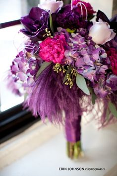 Pink and purple themed wedding flowers created by Lexington Floral in Shoreview, Minnesota.
