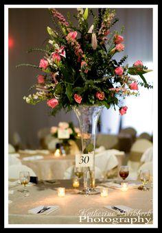 Tall Centerpiece Arrangement with Pink Roses, Stargazer Lilies, Larkspur and Elegant Foliage http://www.busseysflorist.com/bridal-wedding-flowers/