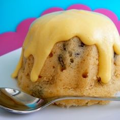 Spotted Dick, a traditional steamed english pudding, here served with warm custard.