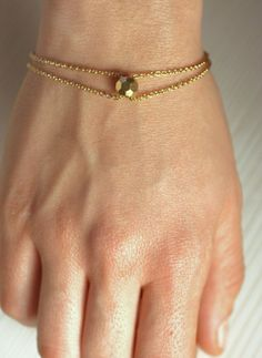 Gold long bracelet with gold bead and gold chain by arrowsrain