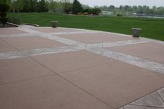 Nice example of how decorative concrete can be used to enhance a concrete patio, without overwhelming it.  Rocky Mountain Concrete Specialists Morrison, CO