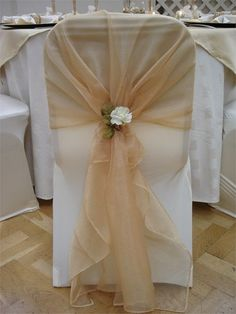 ivory chair cover with gold organza sash and ivory rose tieback decoration from pumpkin events - Rose Gold Wedding Chairs Covers Wedding Chair Decorations, Wedding Chairs, Wedding Centerpieces, Wedding Table, Wedding Chair Covers, Wedding Chair Sashes, Wedding Ideas, White Chair Covers, Chair Bows