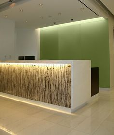 backlit reception desk with absolute white stone top