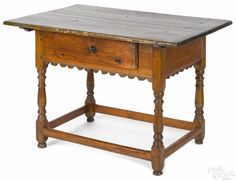 Pennsylvania pine tavern table, 18th c., 28'' h., 41'' w., 27 1/2'' d. Provenance: The Collection of Frank and Sue Watkins, Richmond, Virginia.