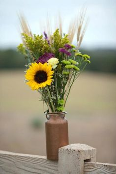 Love the sheaves of wheat with the sunflower.