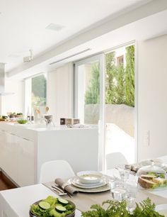 Minimalist White Kitchen With A Summer Feel   DigsDigs