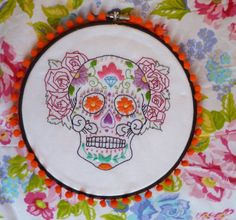 This embroidered and beaded Day of the Dead sugar skull embroidery would be a conversation starter! In an 8 inch black embroidery hoop with an