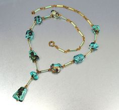 Art Deco necklace with turquoise nuggets and enameled gold links. Offered by boylerpf on Etsy.