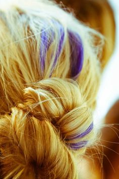 Purple streaks in blonde hair, perfect example of little pops of purple.