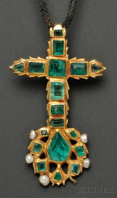 Antique Emerald Pendant, the Greek Orthodox cross set with fancy-cut foil back emeralds, pearl accents,.    Note: Purchased at Lord & Taylor from the Russian Imperial Exhibit ...Accompanied by a letter from Lord & Taylor dated January 27, 1933, and another from the Russian Imperial Exhibit dated January 21, 1933 describing article no. 5127 as a Greek Orthodox cross... Also included is an exhibition tag stating that the cross is from the early 17th century... collection of Grand Duchess…