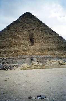 The Pyramid of Menkaure, located on the Giza Plateau in the southwestern outskirts of Cairo, Egypt, is the smallest of the three Pyramids of Giza and is thought to have been built to serve as the tomb of the fourth dynasty Egyptian Pharaoh Menkaure. It was constructed of limestone and granite. The first 16 courses of the exterior were made of granite.