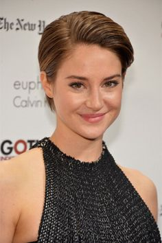 Shailene Woodley keeps her look simple with a pushed back, polished style.