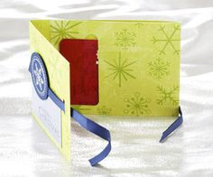 Easy-to-make gift-card holder. Cut paper to 3x11 inches. Score at 3 and 7-1/4 inches. Punch a word window opening on 3-3/4-inch piece. Make sure opening is at least 2-1/2 inches wide for the gift card. Fold in and adhere at top only. Decorate as desired.