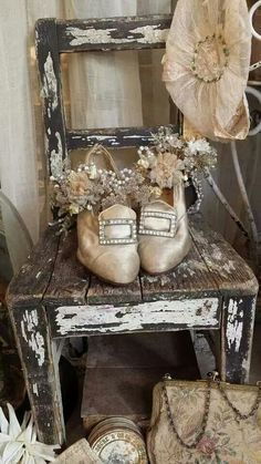 we have an antique pair of bridal shoes in our shop, great idea to decorate them with vintage millinery flowers