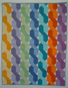 'Twister', using squares and triangles or, better still, elongated hexagons and squares for the twists, while the background is made up of small white triangles.
