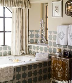 Designer Cathy Kincaid used  Farrow & Ball's Old White paint on the walls of a French-style Arizona's bathroom has the same muted tone as Moroccan Cross and Star tiles by Ann Sacks. Curtains are Cowtan & Tout's Irina Sheer in Sky and Ivory. Indian inlaid cabinet from John Rosselli.