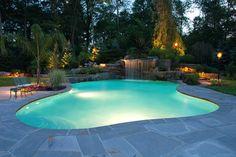 pool landscaping, swimming pools, swim pool, backyard lighting, lighting ideas, pool designs, tiki torches, landscape designs, backyard pools