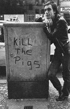 "Iggy. ""Kill the Pigs"" (Pigs was slang for cops, everyone said it without thinking) I think it became a common slogan after Kent State."
