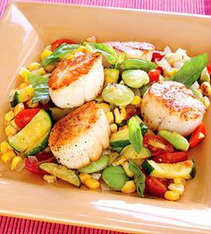 The corn and lima bean side dish boosts the fiber in this low-fat seafood dinner.