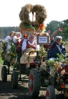 Village Fair in the Uckermark Region (September 16, 2006)  Rural traditions such as rustic village festivals are still being upheld in Germany. Here, a group of rural women on a decorated wagon take part in a festive procession during the Third Brandenburg Village and Harvest Festival in the community of Pinnow (Uckermark). Rising above their wagon is a harvest crown, a wreath made of ears of grain; as part of rural custom, the harvest crown is mounted on the village square to symbolize the…