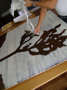 use shelf liner as stencil and paint over old wood flooring boards. whole explanation at website.
