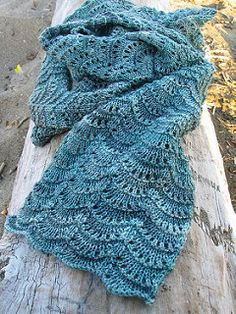 Foggy Seas Scarf by Jennifer de Graaf, free pattern on Ravelry.  (Note:  These are scallops, not feather-and-fan.)