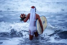Morning of her wedding - a Bride hits the surf... Photo Credit: Alison Ferguson