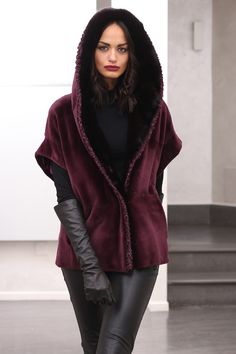 Sheared Female Mink Fur Jacket with whole skins. Made in Italy. Skins Quality: Kopenhagen Fur Platinum; Color: Bourdeaux; Closure: With hooks; Hood; Lining: 100% Satin; Length: 65 cm;