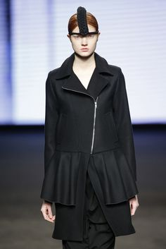 Txell Miras. Black Coat with metal zipper. Winter trend 2016