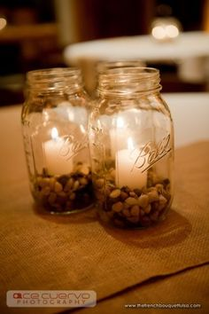 Mason jars with pebbles and candles