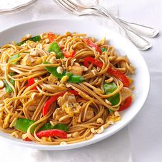Thai Chicken Linguine Recipe -When I'm feeding a crowd, I multiply this Thai-inspired chicken with pasta and snow peas. The merrymaking begins when everybody digs in, even the kids. —Teri Rumble, Jensen Beach, Florida