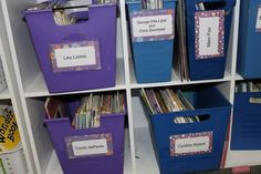 Another fun use of scrapbook paper -- cut into uniform squares, add large labels, laminate, and put on storage bins.