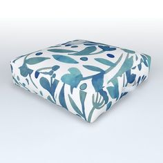 """Find somewhere soft to land. Our outdoor floor cushions are the super comfy and style-forward option for the boho side of us all. They're UV coated to protect against fading and water resistant so you can avoid scrambling to bring them inside whenever there's a touch of weather. Grab a few to have on hand whenever seating is hard to come by or for a fun option for kids to use out in the yard.     - 26"""" x 26"""" x 6"""" D    - Durable, woven polyester    - Cotton twill handle    - Water resistant    - Outdoor Floor Cushions, Floor Pillows, Blue Plants, Teal, Yard, Weather, Handle, Comfy, Flooring"""