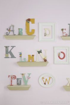 """This sculptural take on a classic nursery alphabet chart couldn't be easier. We chose some letters—we went with a mix of sizes and styles—and painted them to match the room. Then we dotted them with an assortment of whimsical papercrafting embellishments. TIP: Our wooden letters vary in size from 1 1/4"""" to 18""""."""