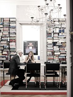 t might look unusual at first, but Karl Lagerfeld stacks his books sideways. It even makes it easier to find the book title you're looking for.