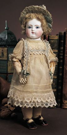 """A Very Rare French Bisque Wooden-Bodied Bebe by Adelaide Huret, circa 1880. Unmarked. 12"""" (30 cm)."""