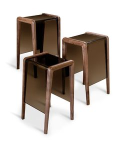 THEO BAR STOOL - JOYCE WANG  smoky lucite seat that is inset in a sculpted walnut frame.