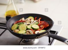 Preparing grilled vegetables such as mushrooms, peppers and zucchini in a pan Stock Photo Stuffed Mushrooms, Stuffed Peppers, Grilled Vegetables, Griddle Pan, Zucchini, Stock Photos, Stuff Mushrooms, Grilled Veggies, Stuffed Pepper