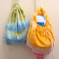 Make a drawstring backpack from a pillow case! No sewing required.... step by step instructions to tie dye, and create the bag.