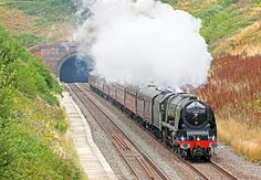 Ex-LMS 'Duchess' Class 4-6-2 46233 'Duchess of Sutherland' emerges from Whiteball Tunnel with the Railway Touring Company 'Royal Duchy' from Bristol to Par and return.