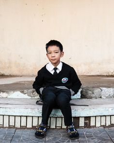 Portrait of a young man waiting for his bus to go to school in Hanoi Vietnam. This image was taken while on assignment for VIB bank where I was to create a story about the people and community surrounding each banking branch. Great assignment! #hanoi #vietnam #photooftheday #photographer #photojournalist #documentary #documentaryphotography #peoplw #portraitphotography #portraitphotographer #portraits #street #streetphotography #picoftheday #natgeo #natgeotravel #natgeotraveler…