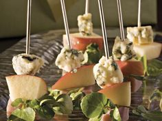Ham-and-Cheese Skewers   Impress your guests with these sophisticated five-ingredient-or-less appetizers. They're elegant, easy, and, because they have so few ingredients, won't break your budget. These recipes range from great dips, fantastic cocktail shrimp platters, or even elegant party crackers. Serve up a great dish of goodies to your guests while making it easy on your budget.