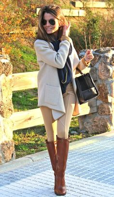 Shop this look on Lookastic:  http://lookastic.com/women/looks/sunglasses-knee-high-boots-skinny-pants-coat-duffle-bag-scarf/8974  — Black Sunglasses  — Tobacco Leather Knee High Boots  — Tan Skinny Pants  — Beige Coat  — Black Suede Duffle Bag  — Navy Scarf