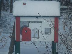 Handmade dove house put on legs and made into a bird house.