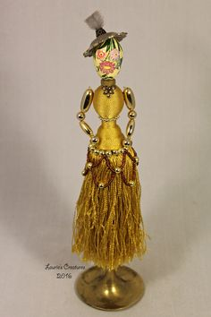 """The Duchess"" ~ Found object, junk art created by Laurie Schnurer in 2016. Body is a drapery tassel. Head is a small decorative egg. To purchase one of Laurie's Creatures go to https://www.facebook.com/LauriesCreatures."
