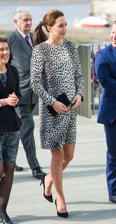 March 11, 2015: Kate Middleton wears her Hobbs dalmation print dress, Stuart Weitzman pumps, Mulberry clutch and Annoushka pearl earrings at today's Turner Contemporary visit