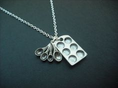 I love this micro mini measuring spoons & cuppycake pan necklace!!...