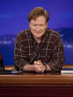 Post-tub, Conan wears a bath robe and slippers for the rest of the show.