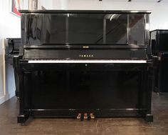 A hand-built, 1980, Yamaha YUA upright piano with a black case and polyester finish at Besbrode Pianos £3950